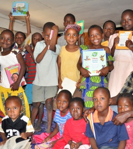 Children of the community supported by Tana River Life Foundation enjoying the books shipped from Singapore. Book Drive 2010