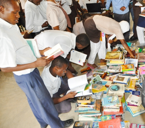 Students from Buyani High School experiencing a llibrary for the first time in their lives. Thank you one and all for your books. You've helped open up their world !
