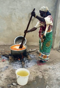 Village women cooking a feast of goat stew and pilau for the PTA meeting with the foundation